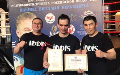 Сергей Батурин получает 10 кхан на семинаре заслуженного тренера Российской Федерации  Виталия Ильина.